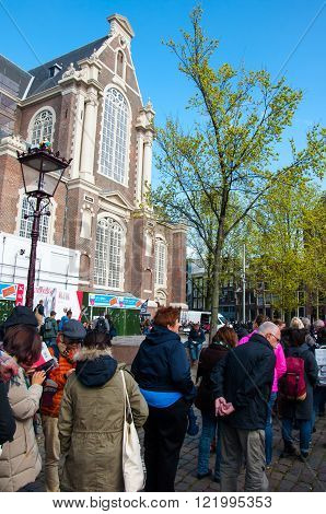 AMSTERDAM-APRIL 30: Tourists stand in a queue for tickets to Anne Frank House Museum on April 302015.The Anne Frank House Museum is one of Amsterdam's most popular and important museums.