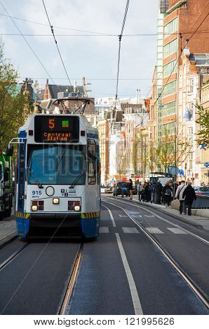 AMSTERDAM-APRIL 30, 2015: Amsterdam public transport on April 30 2015. From Central Station to outlying neighbourhoods the tram is one of the quickest ways to get into and around the city centre.