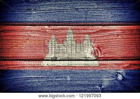 Flag of Cambodia painted on old grungy wooden background