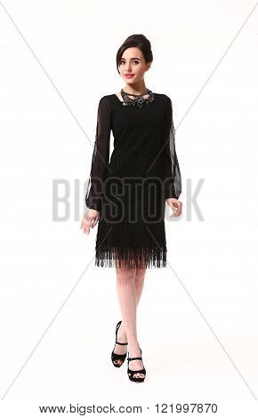 arabian  business executive woman with updo hair style in formal black cocktail party sleeveless dress long sleeve dress high heel shoes standing full