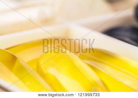 Fatty acid omega 3 fish oil gel capsules macro image selective focus.