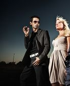 pic of smoking woman  - Elegant couple over a sunset background - JPG