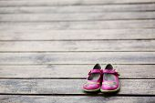 image of pink shoes  - Kid girl small shoes leaved on wood - JPG