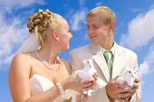stock photo of married couple  - this is a happy just married couple with the doves into there hands - JPG