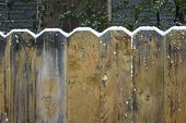 stock photo of wooden fence  - fresh snow accumulating on top of wooden fence - JPG