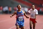KUALA LUMPUR - AUGUST 15: Thailand's amputee athlete Sangat Chaikhini wins the 800m race at the trac
