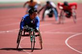 KUALA LUMPUR - AUGUST 16: Thailand's wheel chair athlete wins the 800m race at the track and field e