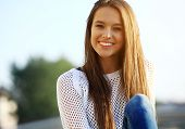 Portrait Of Young Smiling Beautiful Woman. Close-up portrait of a fresh and beautiful young fashion poster
