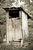 stock photo of outhouses  - traditional wooden thunderbox outside toilet - JPG