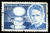 Vintage french stamp depicting Marie Curie who won two Nobel prizes in Physics and Chemistry for her