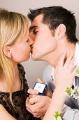 picture of marriage proposal  - Couple kissing after he proposed - JPG