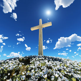 stock photo of christian cross  - cross surrounded by flowers - JPG