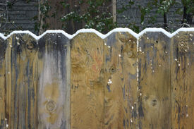 image of wooden fence  - fresh snow accumulating on top of wooden fence - JPG