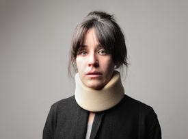 picture of neck brace  - Woman wearing a neck brace - JPG