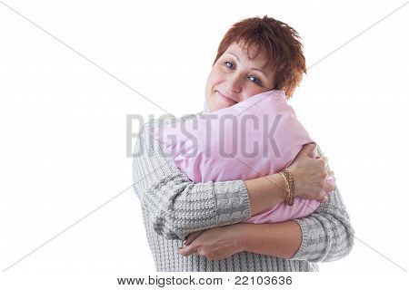 Smiling Woman Hugs Pink Pillow