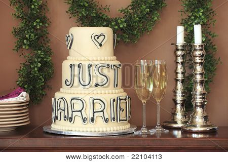 Luxurious Wedding Cake And Two Champagne Flute Glasses