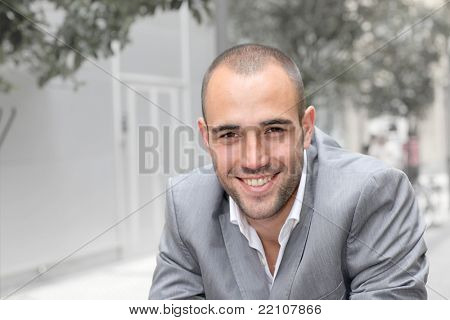 Closeup of smiling businessman in town