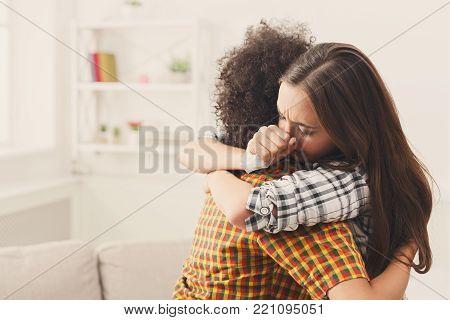 Woman hugging her