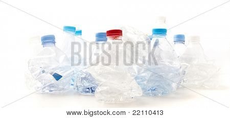 crushed plastic bottles on a white background