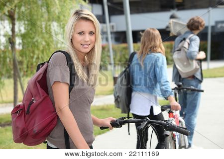 beautiful girl go to the university with her friends