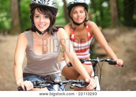 portrait of 2 girls on bikes