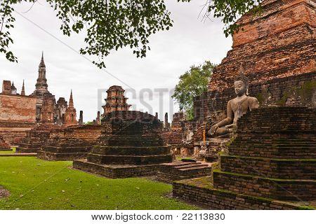 Buddha Statue Among Pagoda Of Wat Mahatat In Sukhothai