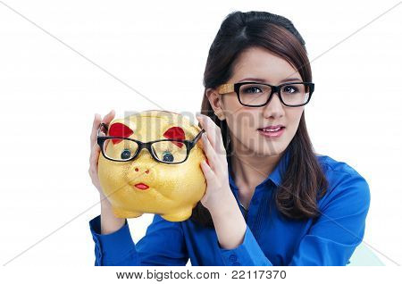 Beautiful Young Woman Holding Piggy Bank