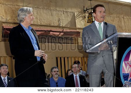LOS ANGELES - DEC 18: James Cameron and Arnold Schwarzenegger at a ceremony as James Cameron receives a star on the Hollywood Walk of Fame in Los Angeles, California on December 18, 2009