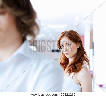 picture of couple in disagreement at home in the living room