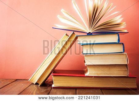 poster of book. many books. Stack of colorful books. Education background. Back to school. Book, hardback colorful books on wooden table. Education business concept. Copy space for text