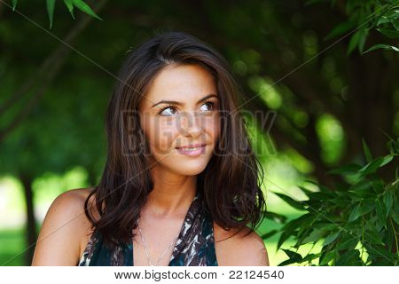 woman on a background of green trees