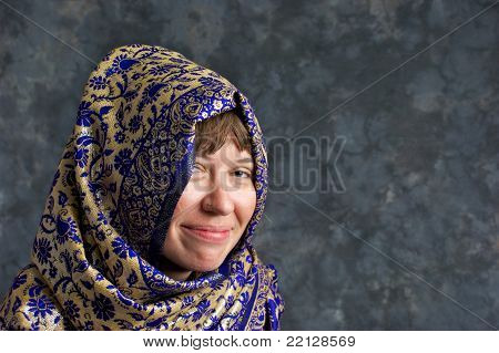 Smiling Woman Wrapped In Blue And Gold Shawl