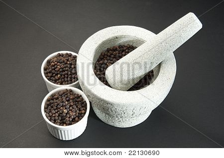 Pestle And Mortar With Black Pepper