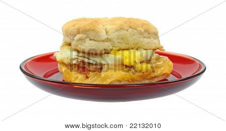 Bacon Breakfast Sandwich On Red Plate