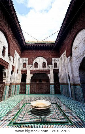 Hand Carved Wood And Mosaic Of Madrasa Courtyard With Fountain