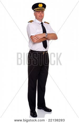 Photo of an airline pilot wearing the four bar Captains epaulettes arms folded, isolated on a white background.