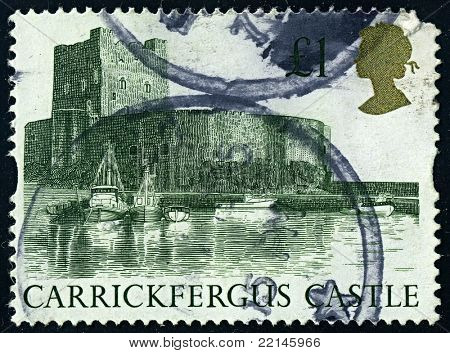 ENGLAND-CIRCA 1992:A stamp printed in ENGLAND shows image of Carrickfergus Castle is a Norman castle in Northern Ireland, situated in the town of Carrickfergus in County Antrim, circa 1992.