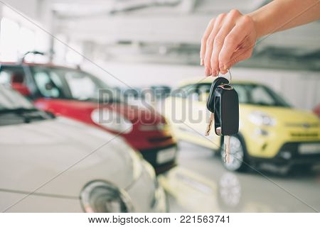 poster of Passing car keys. Cropped closeup of a car dealer holding out car keys to the camera copyspace car dealership salon manager salesman selling buying giving owner profession purchase vehicle concept