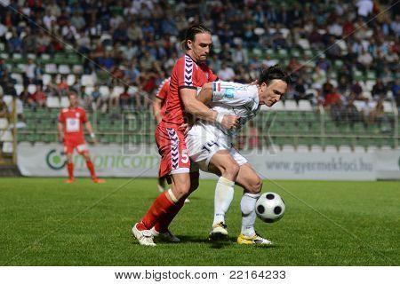 KAPOSVAR, HUNGARY - MAY 14: Lorant Olah (R) in action at a Hungarian National Championship soccer game - Kaposvar vs Szolnok on May 14, 2011 in Kaposvar, Hungary.