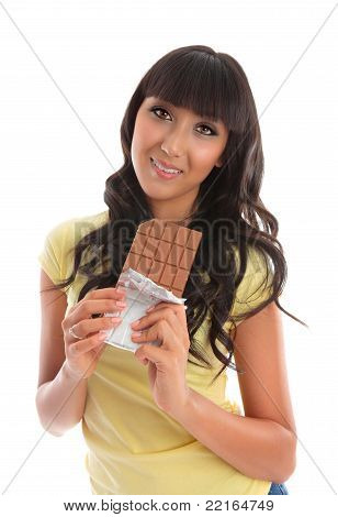 Pretty Young Woman Eating Chocolate