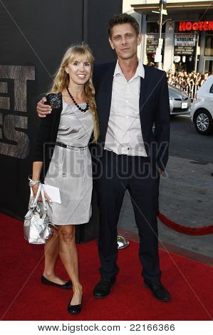 LOS ANGELES, CA - JUL 28: Jamie Harris; Julia Verdin at the Premiere of 'Rise of the Planet of the Apes' at Grauman's Chinese Theatre on July 28, 2011 in Los Angeles, California