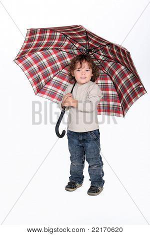 Young boy holding an umbrella