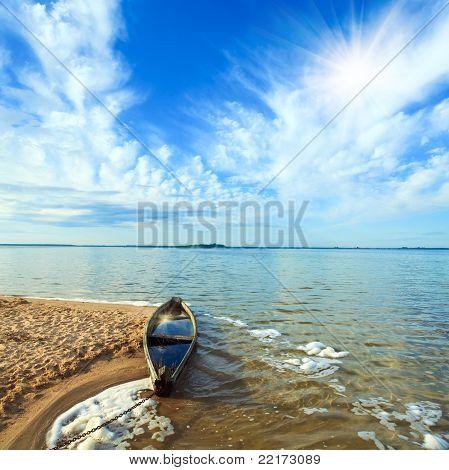 Old Flooding Boat On Summer Lake Shore