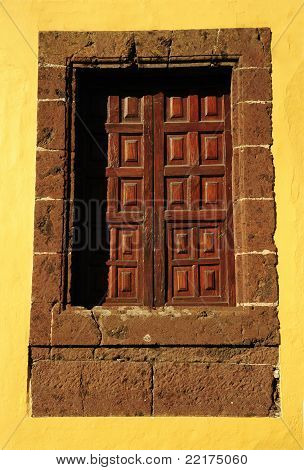 Old Window On Yellow Wall