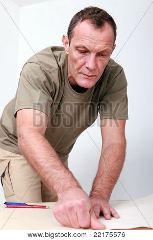 Man preparing wallpaper