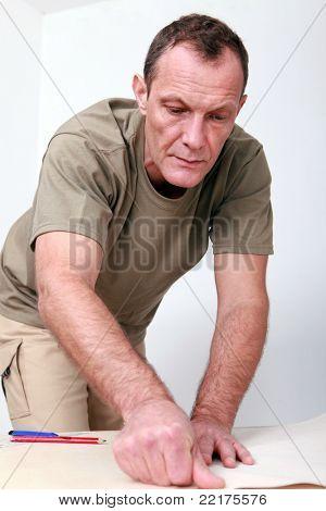 Man preparing wallpaper