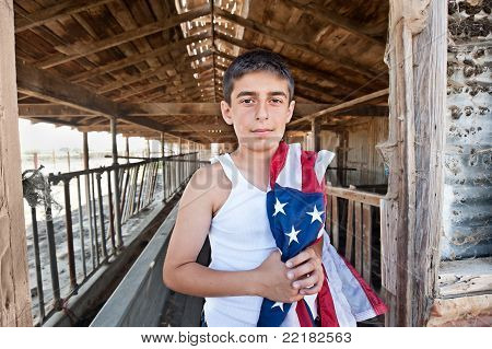 Patriotic Boy In Old Barn
