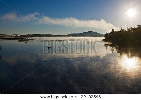 Sunrise and Lonely Rowboat
