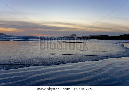 Sunset over Beach with Sand Patterns