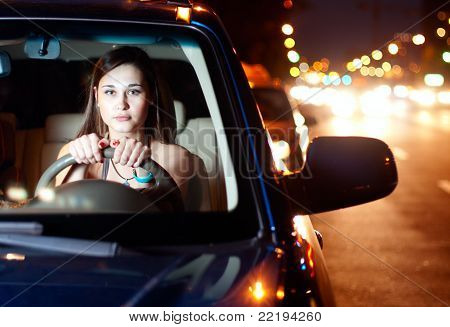 Young Woman Driving Car In The Night City